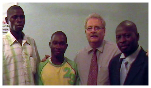 Picture of Dennis Anderson with nationals in Africa